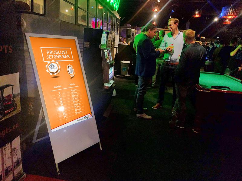 Digital A-board in a bar setting