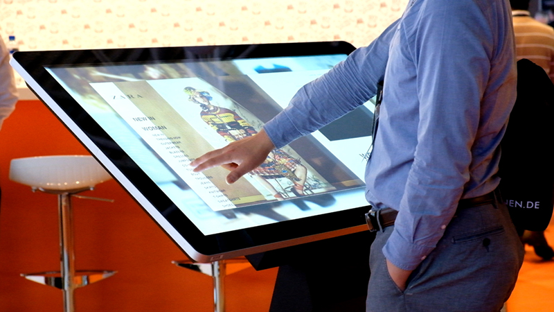 Large touchscreen kiosk in a shop displaying their latest catalogue